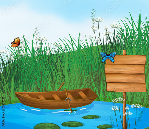 Tuinposter Vlinders A wooden boat in the river