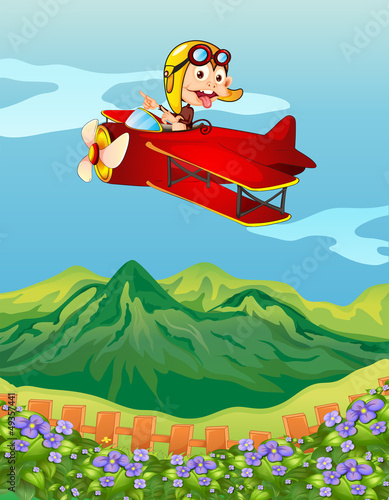 Foto op Plexiglas Vliegtuigen, ballon A monkey on a red airplane