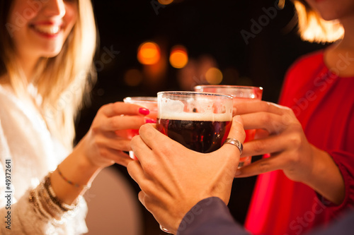 Fotografie, Tablou  Friends having a round of drinks