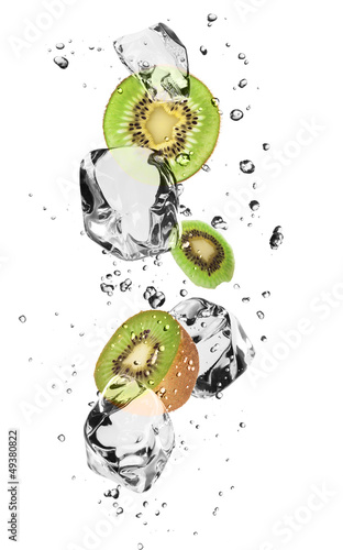 Poster In the ice Kiwi slices with ice cubes, isolated on white background