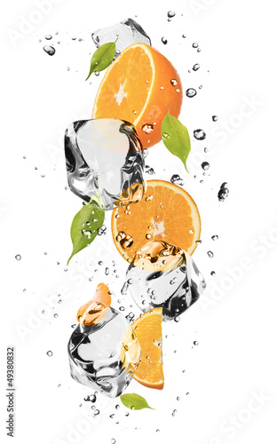 Poster Dans la glace Oranges with ice cubes, isolated on white background