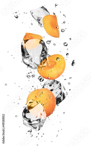 Poster In the ice Apricots with ice cubes, isolated on white background