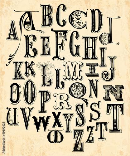 ozdobny-alfabet-w-stylu-vintage-na-zoltym-tle