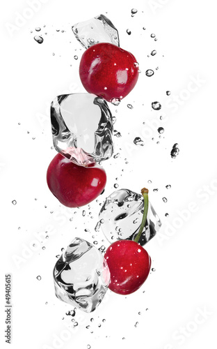 Poster Eclaboussures d eau Fresh cherries with ice cubes, isolated on white background