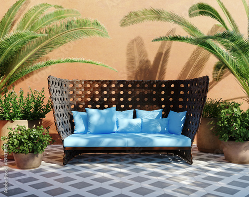 Fotografía  Romantic aged stucco patio with outdoor sofa and plants