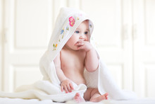 Adorable Baby Girl Sitting Und...