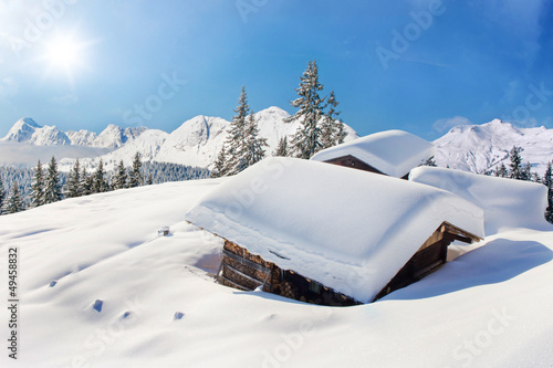 Snow covered hut winter landscape #49458832