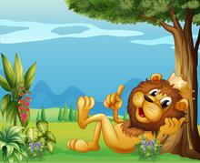 A King Lion Relaxing Under A B...
