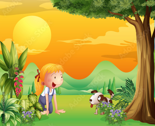 Tuinposter Honden A girl playing with a dog