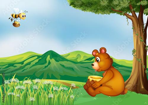 Papiers peints Ours A bear sitting near a tree