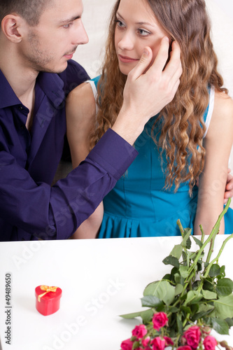 young man and woman looking to each other Wall mural