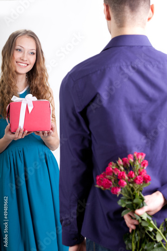 couple giving presents to each other Wall mural