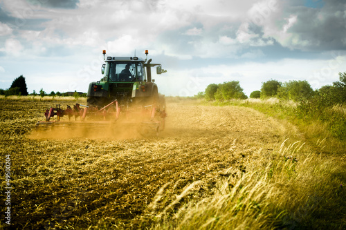 Tractor ploughs field