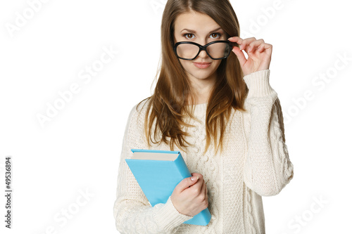 Fotografía  Stern young woman looking over top of eyeglasses