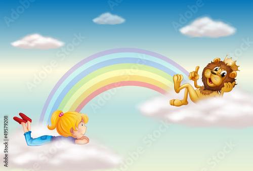 In de dag Regenboog A girl and a king lion across the rainbow
