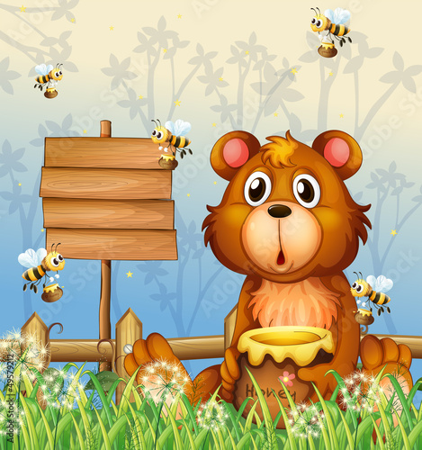 Wall Murals Bears A bear and bees near a signage