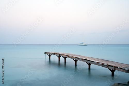 Fototapeta Jetty in the mediterranean sea early in the morning obraz na płótnie