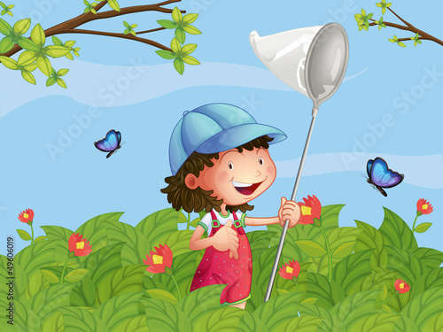 Tuinposter Vlinders A girl with a cap catching butterflies