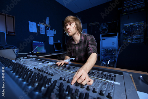 Fototapeta  Man using a Sound Mixing Desk