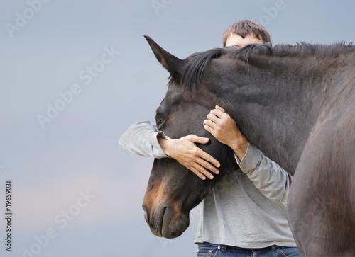 Foto auf AluDibond Pferde Mann und Pferd.