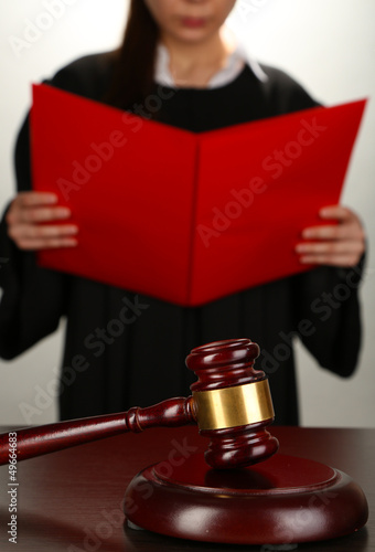 Fotografija  Judge read verdict on grey background
