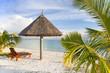 sunshade and sunbed at a tropical beach