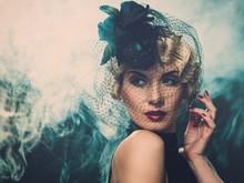 Elegant Blond Retro Woman  Wearing Little Hat
