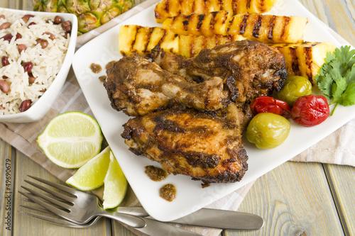 Keuken foto achterwand Kip Jerk Chicken - BBQ chicken, grilled pineapple and rice & peas