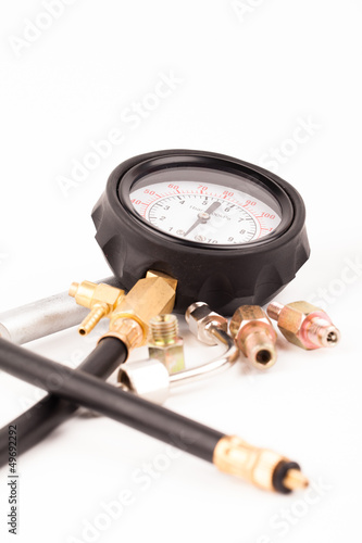 Fotografering  pressure gauge and tools isolated on white