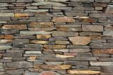 Fototapeta Kamienie - new build flush dry stone wall