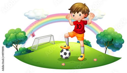 In de dag Regenboog A boy in a soccer field