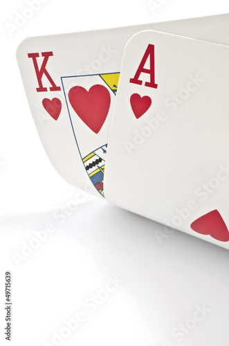 Fotografia Playing cards in poker isolated over white