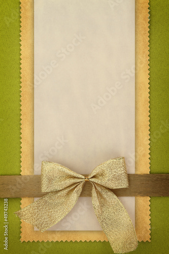 Greeting card with golden bow
