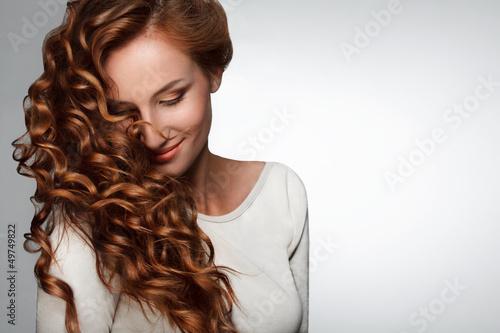 Obraz na plátně Red Hair. Woman with Beautiful Curly Hair
