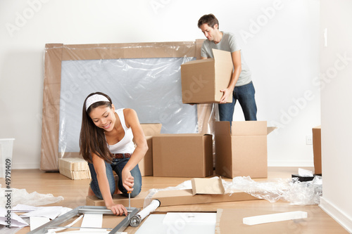 Fotografiet  Couple moving in new home house