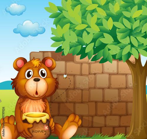 Wall Murals Bears A bear with honey near a pile of bricks