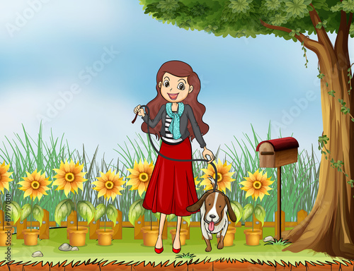 A woman with a dog at the garden