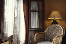 Wicker Chair Next To Window