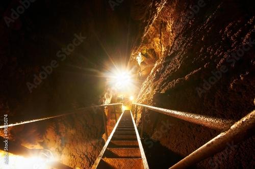 Foto op Aluminium Rudnes Underground sataircase a cave with bright lighr