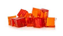 Orange Jelly Cubes On White Ba...