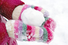 Girl Holding A Snowball