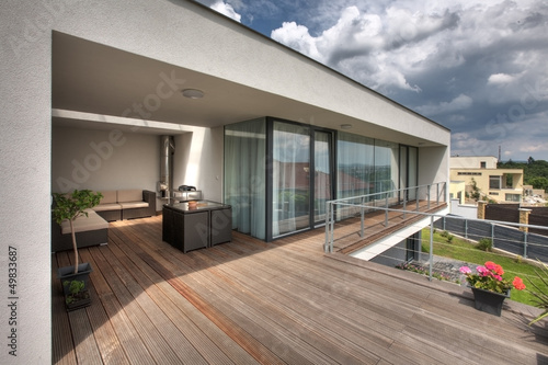 Stampa su Tela timber pool deck on modern home terrace