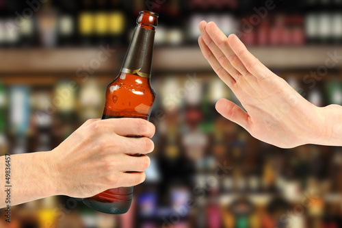 Aluminium Prints Bar hand reject a bottle of beer in the bar