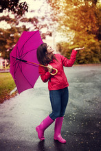 Happy Woman With Umbrella Chec...