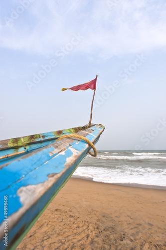 Fotografie, Obraz  Small flag on the bow of a fishing boat, Puri, Orissa, India