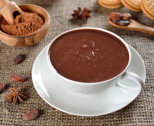 Foto op Plexiglas Chocolade Hot chocolate on a jute background