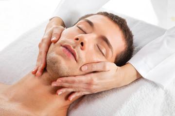 Fototapeta na wymiar Young man receiving facial massage