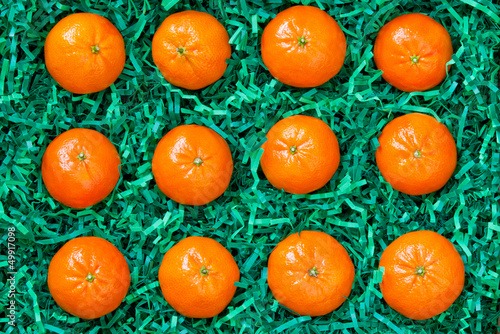 Valokuva  Fresh mandarins packed carefully, oranges background