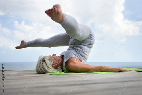 Woman performing a yoga position Canvas-taulu