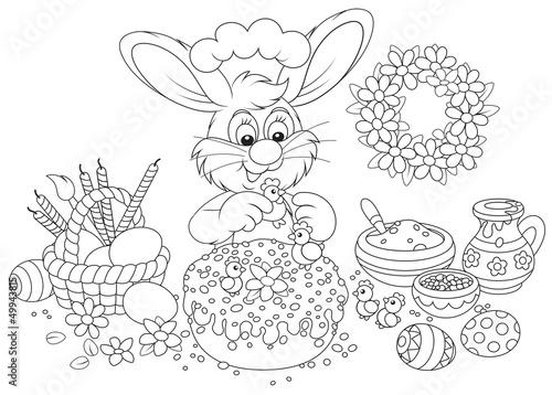 Tuinposter Doe het zelf Rabbit decorating an Easter cake